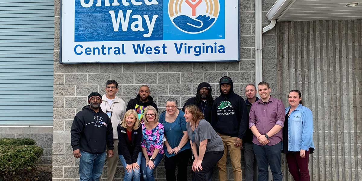 Mardi Gras team in front of United Way of Central West Virginia after dropping off food donation