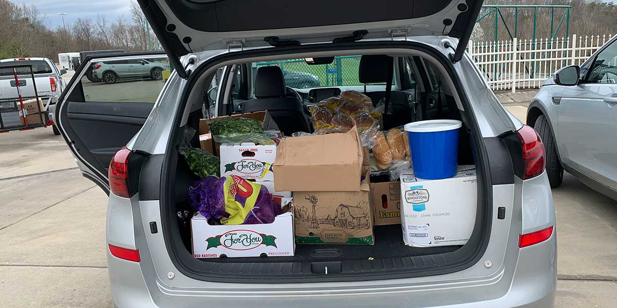 Vehicle loaded with food for Team Mardi Gras to donate to United Way of Central West Virginia